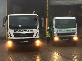 Smallwaste lorries in the rain