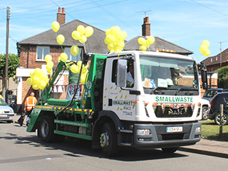 Smallwaste lorry with balloons on